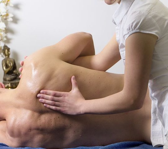 a man getting a back massage