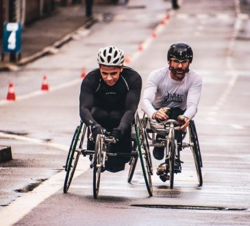two men in a wheelchair