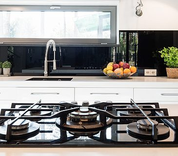 Contemporary minimalist kitchen with mirror splashback