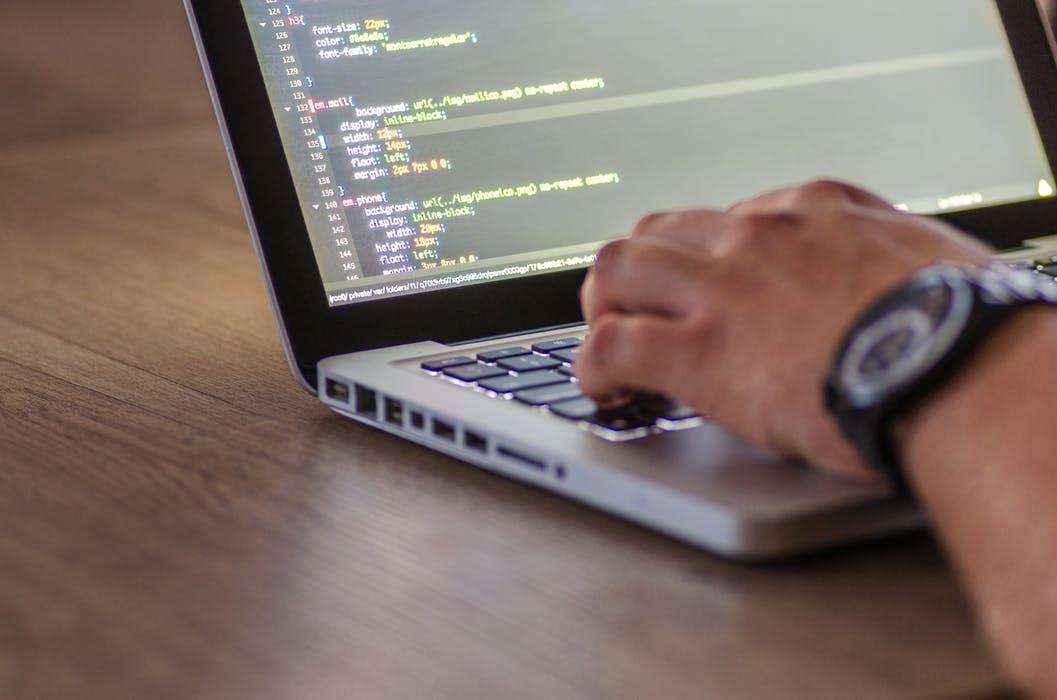 Person coding for website development