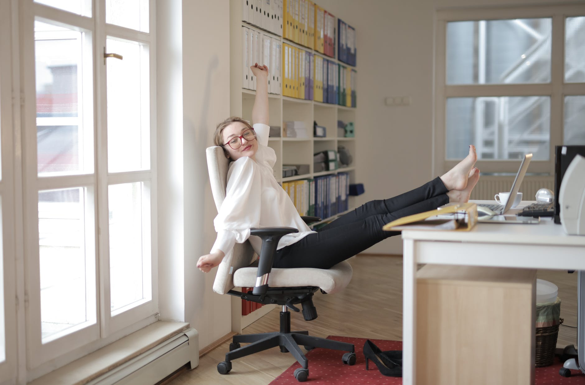 woman sitting on her home office chair for remote internships