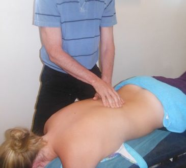 Woman getting treatment from a Norwest Chiropractor